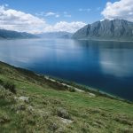 a landscape photo of a lake and some hills in New Zealand. This picture is the feature photo for the New Zealand section of Life Worth the Living