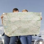 two people looking at a map. This picture is the feature photo for the Travel Tips section of Life Worth the Living