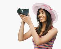 A woman holding a video camera. This picture is the feature photo for the Videos section of Life Worth the Living