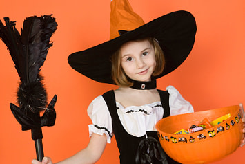 young girl dressed up for Halloween, family-friendly Halloween traditions
