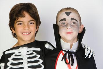 two boys wearing Halloween costumes