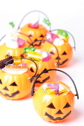 Halloween pumpkins with treats, family-friendly Halloween traditions