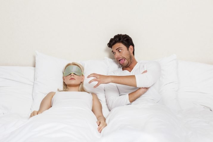 man demonstrating a gesture of frustration towards his partner