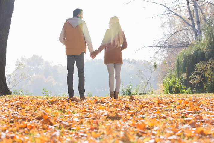 couple holding hands on a walk