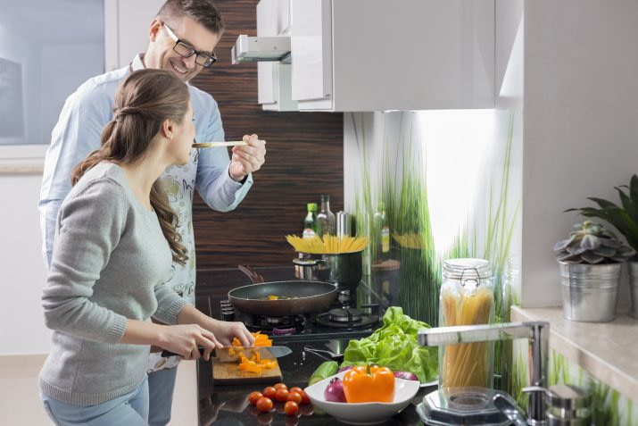 husband spoon feeding wife in a romantic gesture