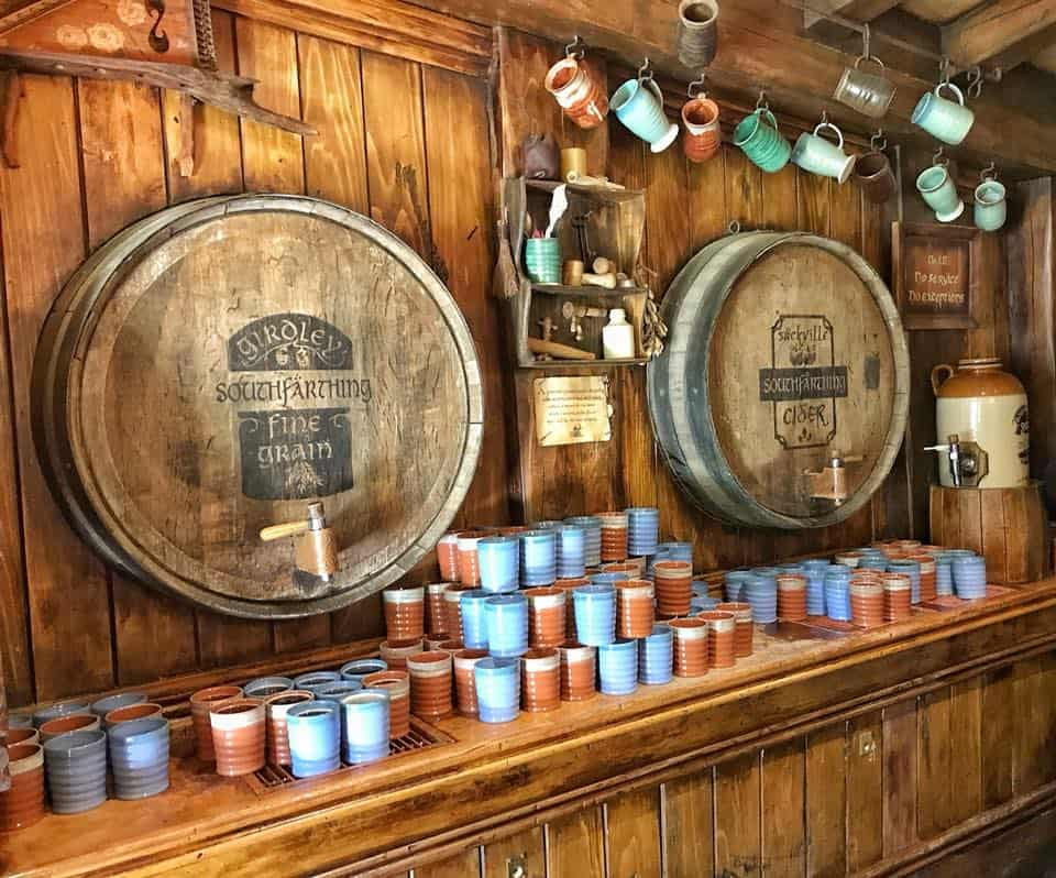 A view of the Green Dragon pub with two barrels and lots of mugs